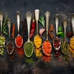 colourful spice blends on arranged teaspoons