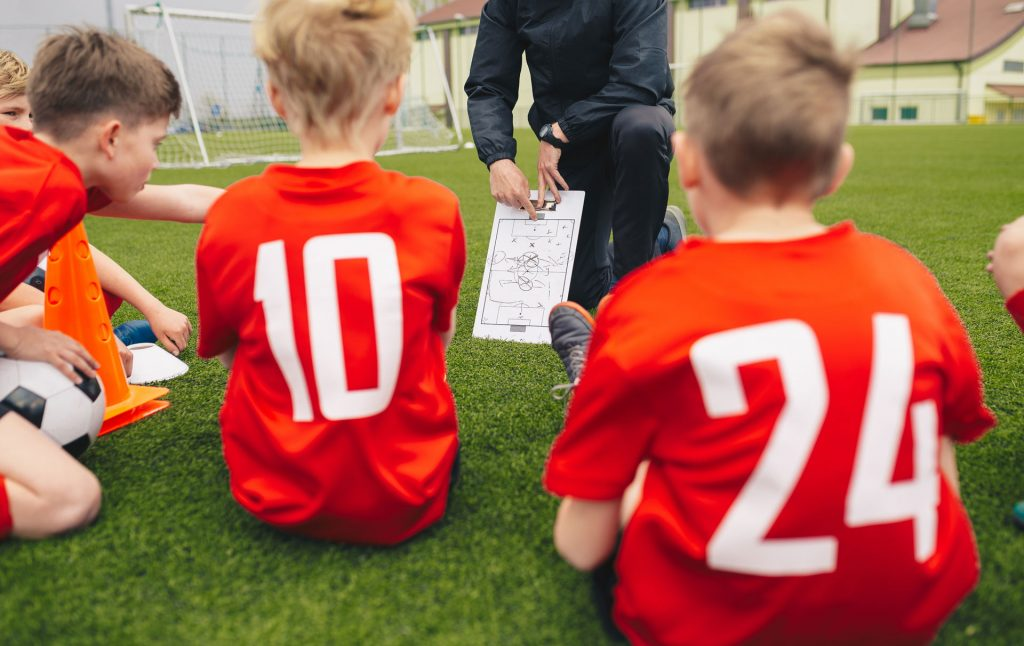 coaching young soccer players